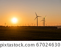 Black Silhouette of windturbines energy generator on amazing sunset at a wind farm in germany 67024630