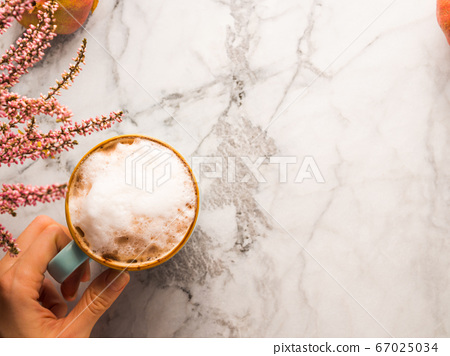 Autumn flat lay with mug of latte coffee on marble 67025034