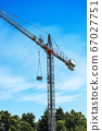 Construction Crane on Blue sky with Clouds 67027751