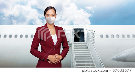 asian woman air hostess in red uniform with white 67033677
