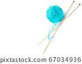 Ball of woolen thread and knitting needles 67034936