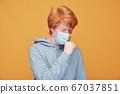 Man having coronavirus symptom 67037851
