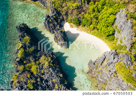 El Nido Palawan National Park. Hidden lagoon and lime stone rocks. White beach on tourist routes in the Philippines. Rocky formations on a tropical beach 67050503