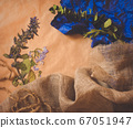 Dry blue flowers on brown and blue natural paper. Free copy space for text. 67051947