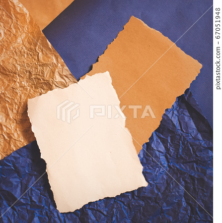 Couple of natural brown and white blank sheets on a crumpled blue and brown paper. Design templates with free copy space for text.  67051948
