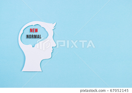 Human head made from paper cut with text New Normal inside. New normal after covid-19 pandemic. 67052145