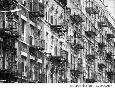 Manhattan old residential buildings with fire escapes 67055267
