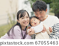 Smiling baby boy and parents 67055463
