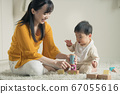 Baby and mother playing with blocks 67055616