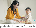Baby and mother playing with blocks 67055632
