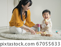 Baby and mother playing with blocks 67055633