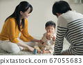Baby and parents playing with blocks 67055683