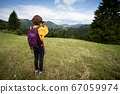tourist girl standing at  the meadow 67059974