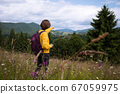 tourist girl standing at  the meadow 67059975