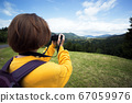 tourist girl standing at  the meadow 67059976