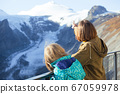 Two teenage girls on the background of the glacier 67059978