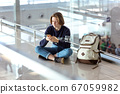 waiting for a flight at the airport 67059982