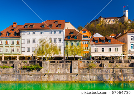 Beautiful cityscape of Ljubljana with colorful historical buildings and the Castle in the background 67064756