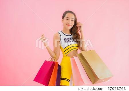 Portrait beautiful young asian woman with shopping bag 67068768
