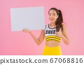 Portrait beautiful young asian woman show white empty billboard 67068816