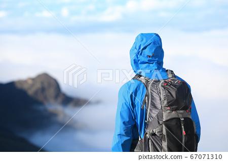 Hiker looking at view 67071310