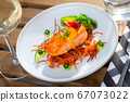 Fried trout steak with carrot brushwood, broccoli, cucumber, figs 67073022