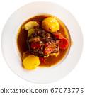 Baked lamb shoulder with vegetables 67073775