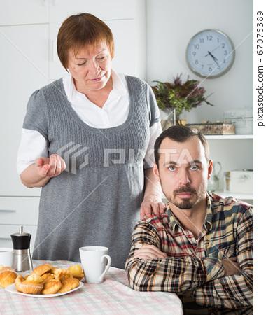 Elderly mother teaches her son 67075389