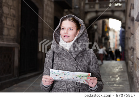 female in the historical center with map 67075917