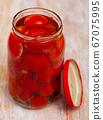 Tomatoes marinated in jars 67075995
