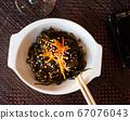 Seaweed salad in white bowl 67076043