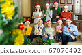 Family on couch during Christmas celebration 67076492