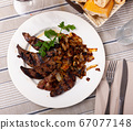 Tasty cooked fried liver pork with fried onion 67077148