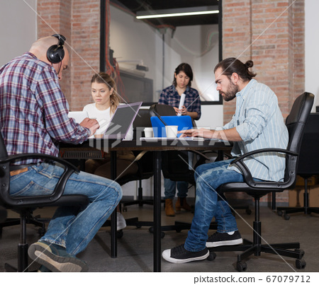 People working in co-working space 67079712