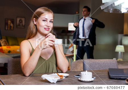 Elegant woman with cup of coffee 67080477