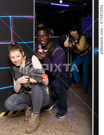 Two lucky laser tag players during lasertag game 67081892