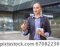 Employee woman with tablet touching finger on air 67082236