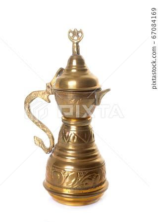 brass teapot in studio 67084169