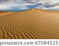Sunset over the sand dunes in the desert 67084525