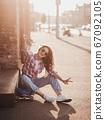 beautiful young woman model on skateboard 67092105