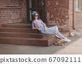 cool young woman model with skateboard 67092111