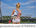 girl in an American T-shirt with roller skates 67096943