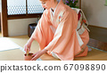 Tea ceremony A foreigner woman who makes matcha with chasen Japanese culture experience 67098890