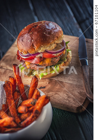 american hamburger with glass of beer in american restaurant or pub 67101104