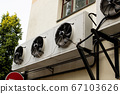 Large air conditioning on wall of building 67103626