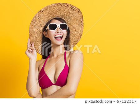 young beautiful woman wearing swimsuit bikini 67122317