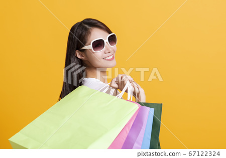 happy young woman holding the shopping bags 67122324