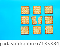 Crackers with sugar on blue background. 67135384