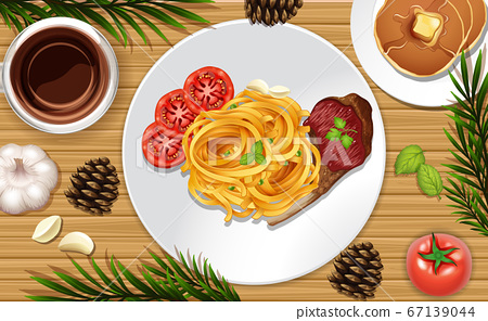 Spagetti and steak close up on desk background 67139044