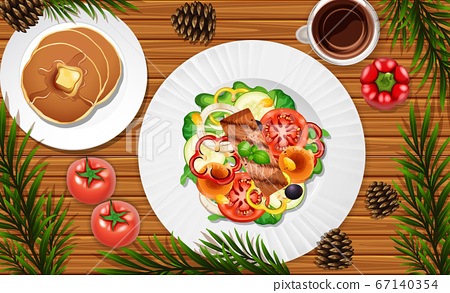 Salad and pancake close up on desk background with 67140354